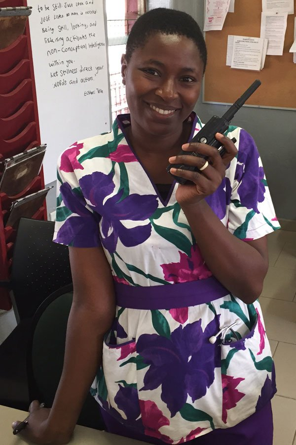 Egbe woman with walkie-talkie radio
