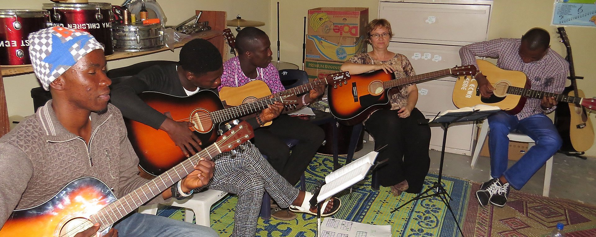 Guitar students and teacher at egbe music school