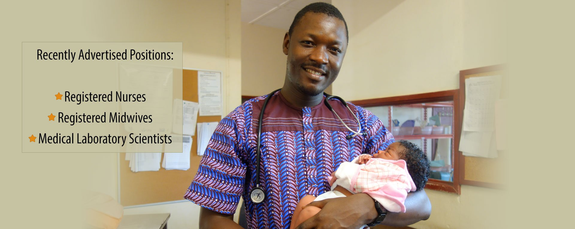 Doctor holding baby at Egbe Hospital