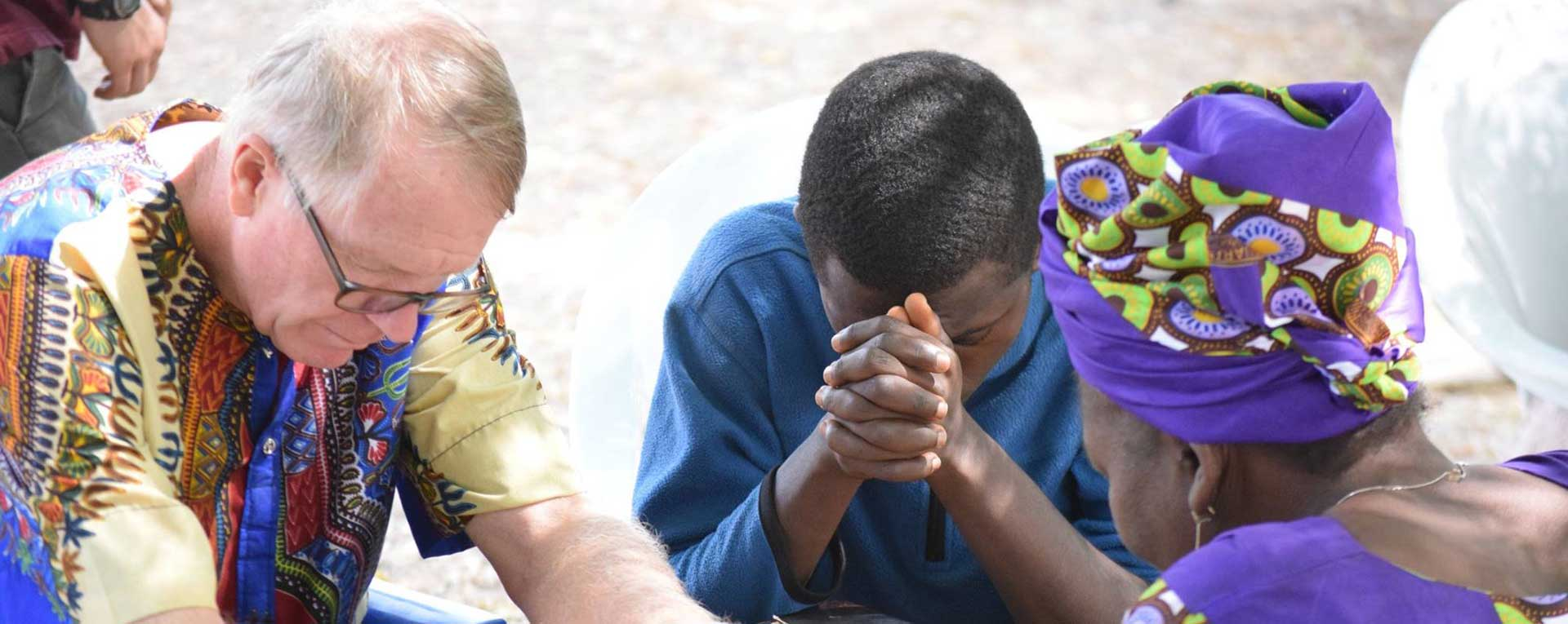 prayer in Egbe with missionary consultants