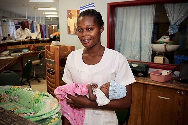 Egbe Nurse holding baby