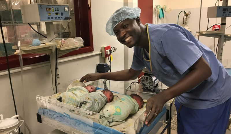 Dr Anthony Joseph with his triplets
